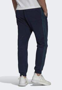 adidas Originals - WW SWEATPANT SPRT COLLECTION ORIGINALS SLIM TRACK PANTS - Träningsbyxor - blue - 1