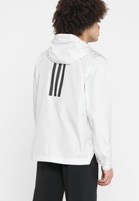 adidas Performance - URBAN - Cortaviento - raw white - 2