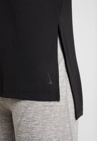 Nike Performance - YOGA LAYER - T-shirts - black - 5