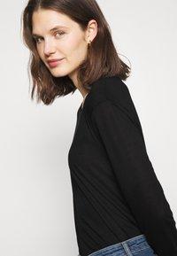 Marks & Spencer London - RELAXD CREW - Long sleeved top - black - 3
