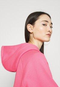 Nike Sportswear - HOODIE - Jersey con capucha - pink glow/black - 5