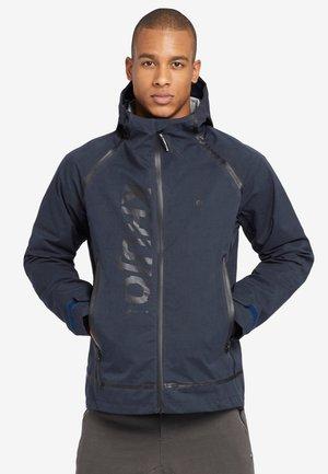 PHRASE - Waterproof jacket - blue