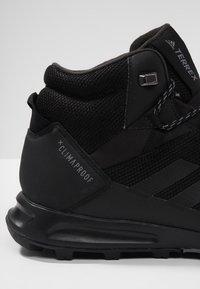 adidas Performance - TERREX TIVID MID CLIMAPROOF HIKING SHOES - Obuwie hikingowe - black - 5