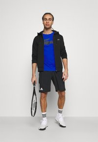 Lacoste Sport - TAPERED - Hoodie - black/navy blue - 1