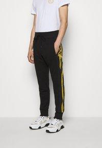 Versace Jeans Couture - Tracksuit bottoms - black - 0
