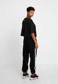 Nike Sportswear - Pantalon de survêtement - black/sail - 3