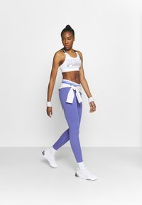 Puma - AMPLIFIED LEGGINGS - Leggings - hazy blue - 1