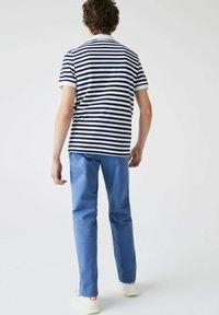 Lacoste - Polo shirt - bleu  blanc - 1