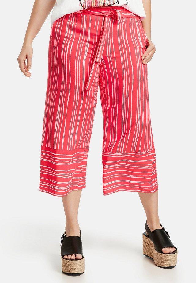 MIT STREIFENMUSTER LOTTA - Trousers - watermelon