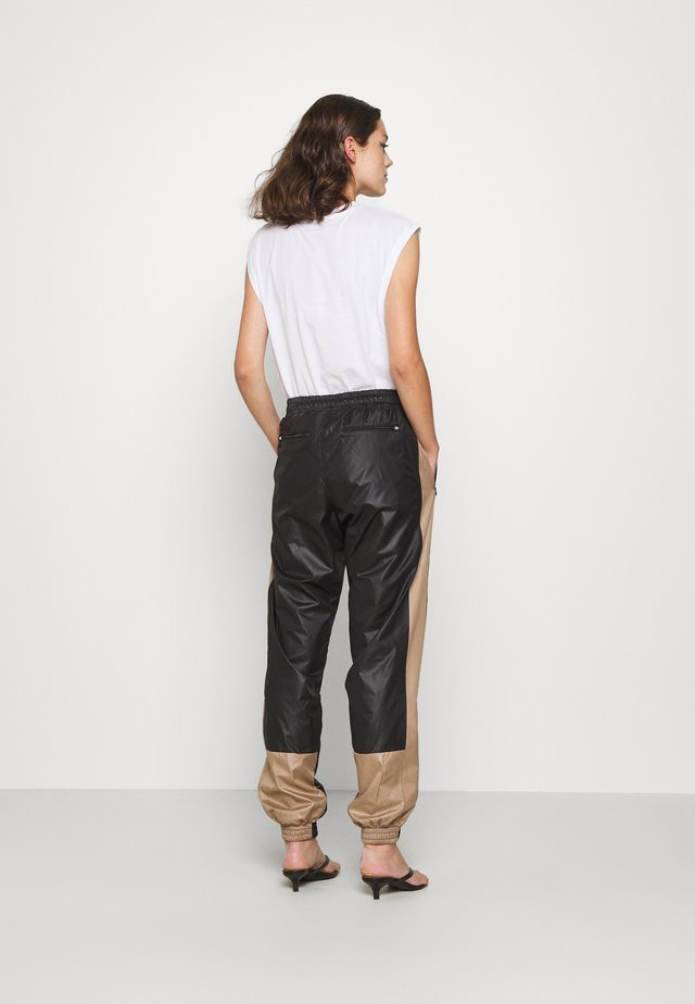 ALWAYS TRACK PANTS - Pantalon de survêtement - black