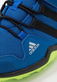 adidas Performance - TERREX AX2R UNISEX - Hiking shoes - glow blue/core black/signal green - 2