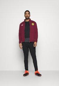 Puma - BVB BORUSSIA DORTMUND CULTURE TRACK  - Club wear - burgundy/cyber yellow - 1