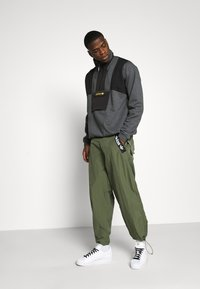 adidas Originals - TRIAL PANT - Trousers - green - 1