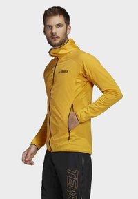 adidas Performance - TERREX SKYCLIMB FLEECE JACKET - Fleece jacket - yellow - 4