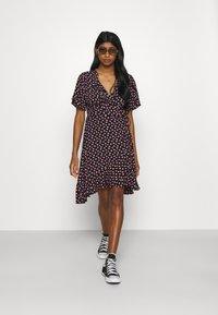 Colourful Rebel - TELSI HEARTS WRAP DRESS - Day dress - black - 1