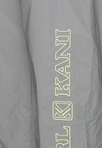 Karl Kani - RETRO SHINY TRACKPANTS - Tracksuit bottoms - light grey - 6