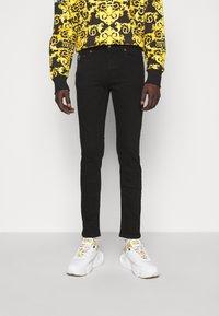 Versace Jeans Couture - AMETIST  - Slim fit jeans - black - 0