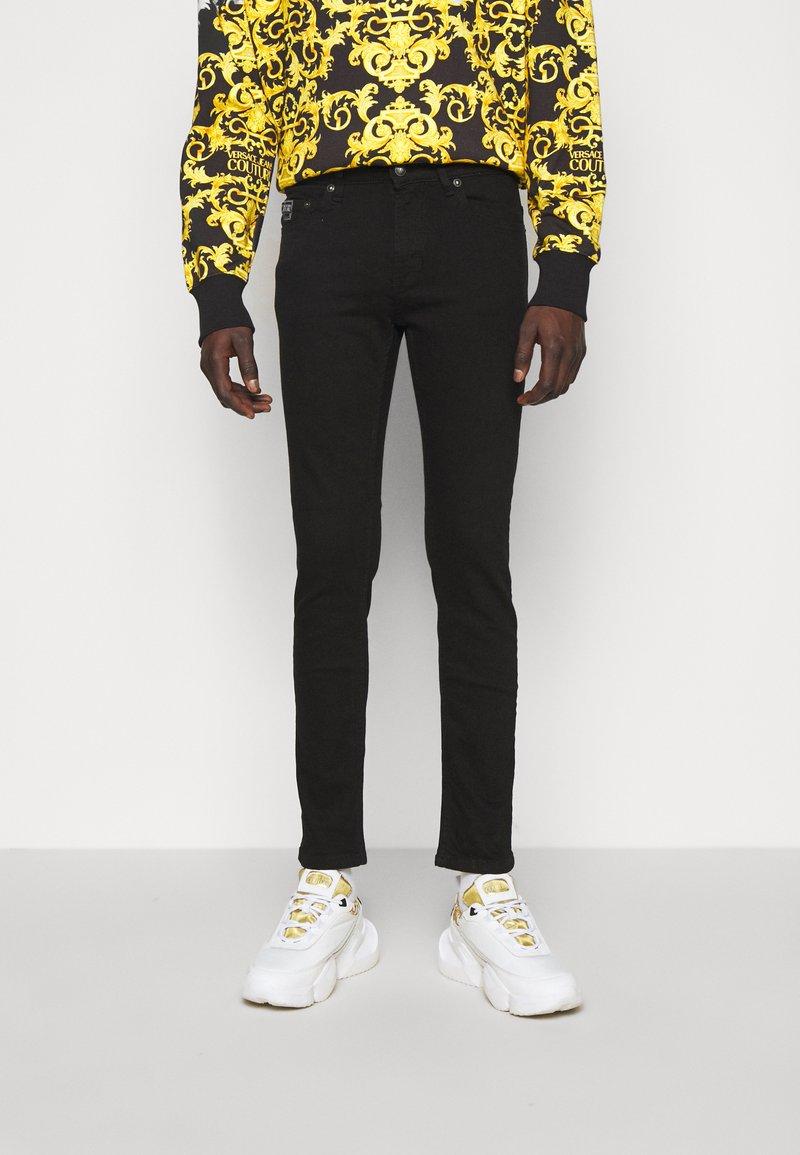 Versace Jeans Couture - AMETIST  - Slim fit jeans - black
