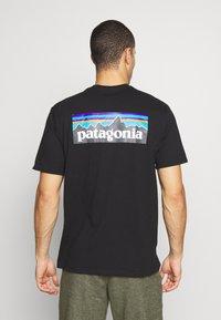 Patagonia - LOGO RESPONSIBILI TEE - T-shirt print - black - 0