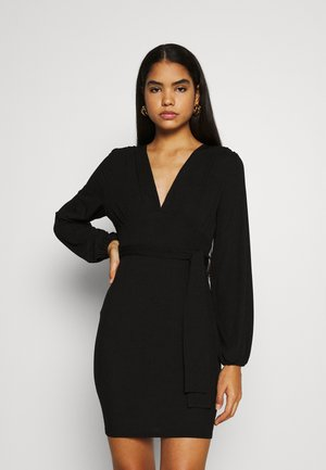 SLINKY TIE BELT PLUNGE MINI DRESS - Jerseykjole - black