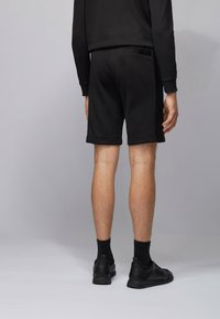 BOSS - HEADLO BATCH Z - Pantalon de survêtement - black - 2
