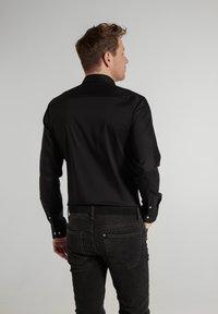 Eterna - SLIM FIT - Formal shirt - schwarz - 1