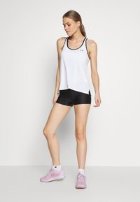 Under Armour - KNOCKOUT TANK - Sports shirt - white/black - 1