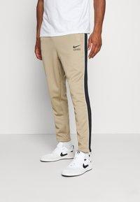 Nike Sportswear - PANT - Træningsbukser - khaki/black/white - 0