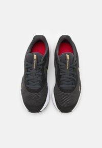 Nike Performance - REVOLUTION 5 UNISEX - Neutral running shoes - dark smoke grey/metallic gold/university red/yellow - 3