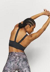 Reebok - SCULPT BRA - Medium support sports bra - black - 2