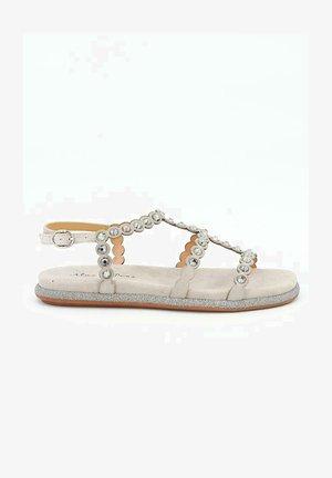 GUINEA - Sandals - sand