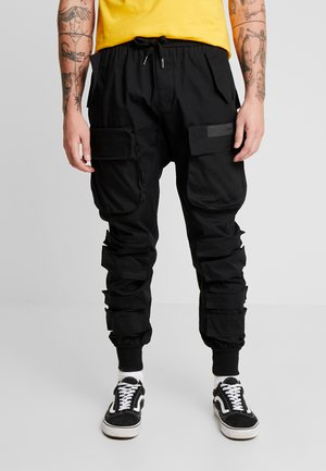 PANTS WITH MULTIPLE POCKETS - Cargobukse - black