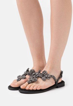 TINA - T-bar sandals - black