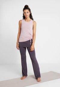 Curare Yogawear - LONG PANTS SKIRT - Tracksuit bottoms - aubergine - 1