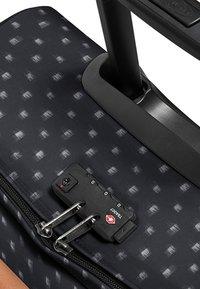 Eastpak - TRANVERZ S AMINIMAL - Wheeled suitcase - check bleach - 6
