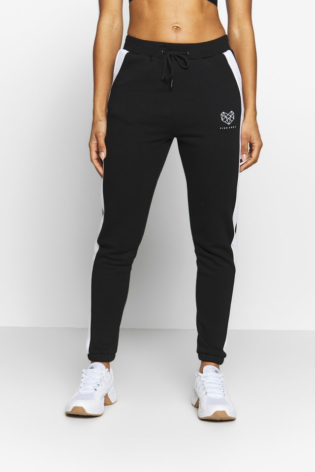 YARROW - Tracksuit bottoms - black/white
