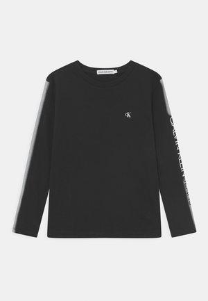 INSTITUTIONAL SPRAY - T-shirt à manches longues - black