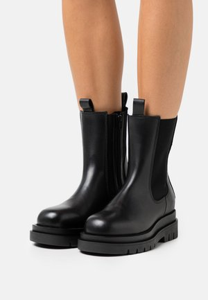 TEODORA - Platform ankle boots - black