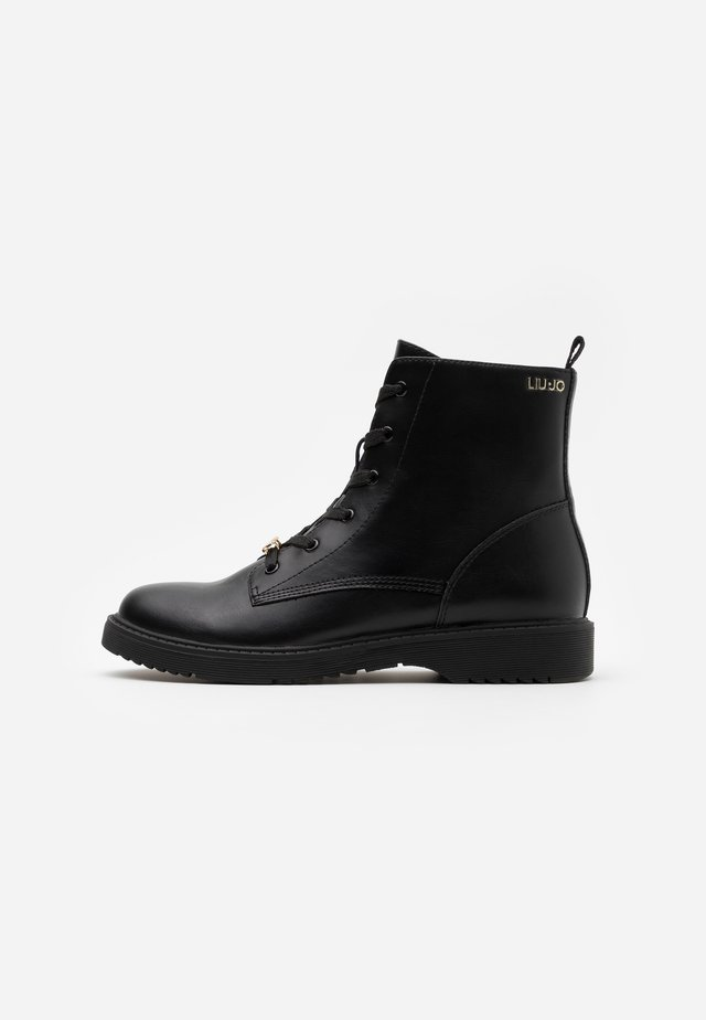 PAT  - Classic ankle boots - black