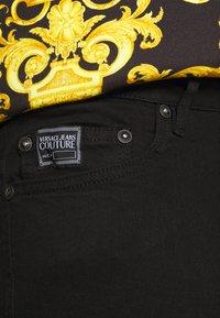 Versace Jeans Couture - AMETIST  - Slim fit jeans - black - 5