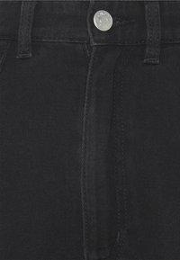 Monki - NANI TROUSERS - Široké džíny - black dark asia - 2