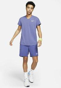Nike Performance - T-shirt basic - dark purple - 1