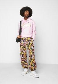Versace Jeans Couture - JOGGERS - Spodnie treningowe - black - 1