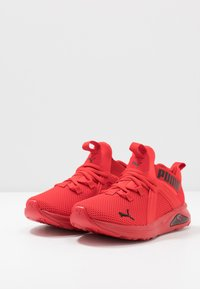 Puma - ENZO 2 WEAVE JR UNISEX - Chaussures de running neutres - high risk red