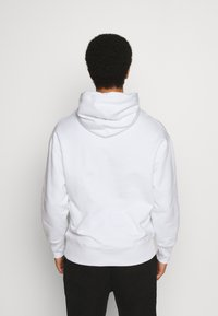 Tommy Jeans - BADGE HOODIE UNISEX - Sweat à capuche - white - 2