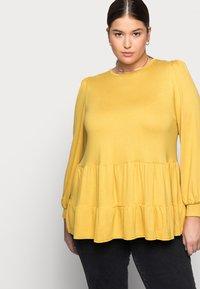 New Look Curves - TIER PEPLUM - Long sleeved top - dark yellow - 3