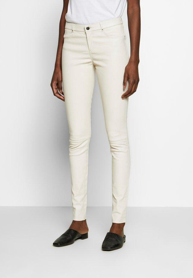 TARTE TATIN - Leather trousers - white