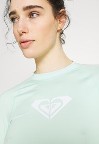 Roxy - WHOLEHEARTED - Rash vest - brook green