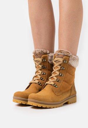 TUSCANI  - Winter boots - ochre