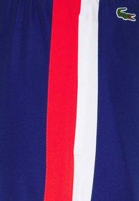 Lacoste Sport - TRACKSUIT BOTTOMS - Pantalon de survêtement - blue - 5